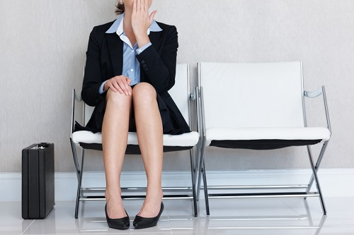 Mid adult businesswoman sitting on chair